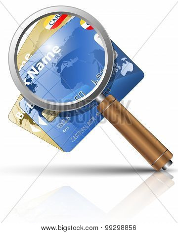 Credit Cards And Magnifying Glass
