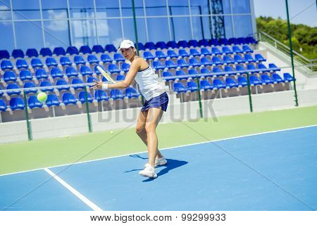 Beautiful Female Tennis Player In Action