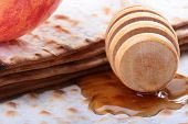 pic of sukkoth  - Honey with a special spoon matzah and nectarine - JPG