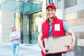 picture of packages  - Colorful picture of courier delivers package for woman - JPG