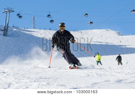 Skier Skiing On Ski Slope