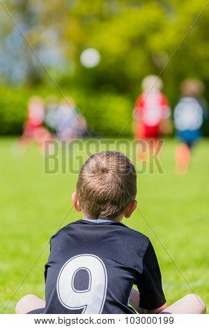Young Boy Watching A Kids Soccer Match
