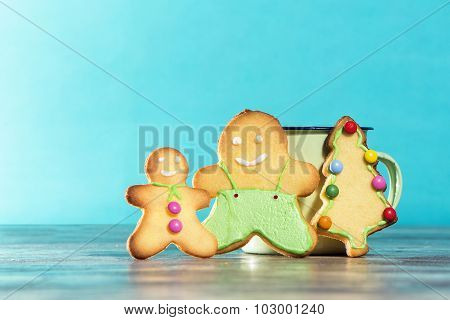 Christmas Cookies And Tin Cup On A Blue Background