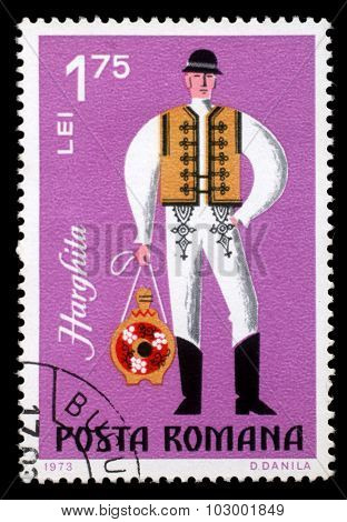 ROMANIA - CIRCA 1973: A stamp printed in Romania shows image of a Harghita man, from the regional costumes series, circa 1973