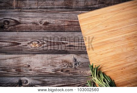 cutting board with space for text on old wooden background