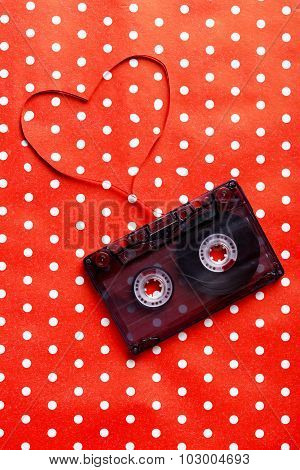 Audio Tape Cassette On Red Paper Background