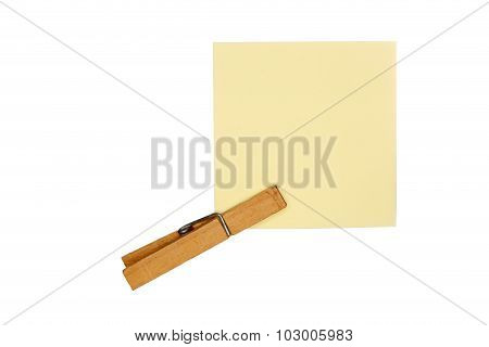 Wooden Peg And Yellow Paper