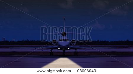 Front view of a private jet on the runway at night