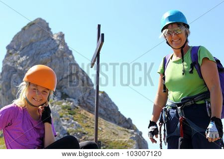 Mother And Daughter Are Climbing