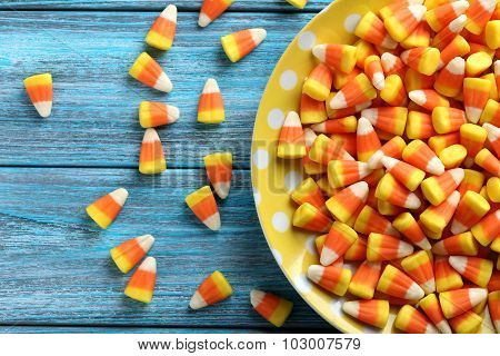 Halloween Candy Corns In Plate On Blue Wooden Background