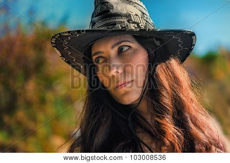 The Girl's Portrait In A Cowboy's Hat