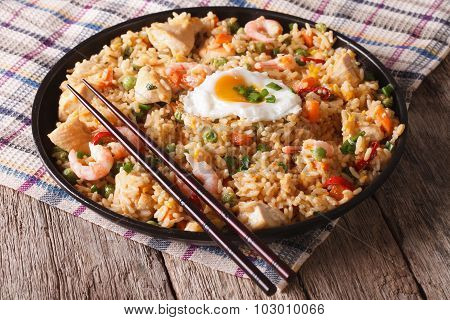 Fried Rice With Chicken, Prawns, Egg And Vegetables Closeup Horizontal