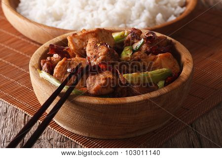 Traditional Kung Pao Chicken In A Bowl Close-up. Horizontal