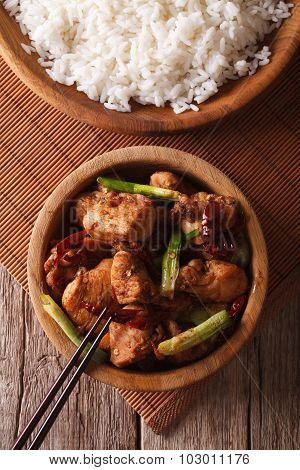 Kung Pao Chicken In A Bowl Close Up And Rice. Vertical Top View
