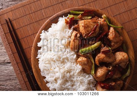 Rice With Spicy Kung Pao Chicken Close-up. Horizontal Top View