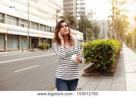 Young Lady Looking Away While Walking Outdoors