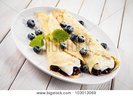 Crepes with blueberries and cream