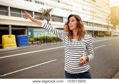 Young Caucasian Woman Hailing A Cab