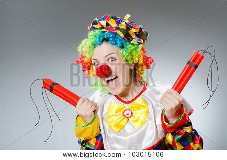 Clown with dynamite in funny concept