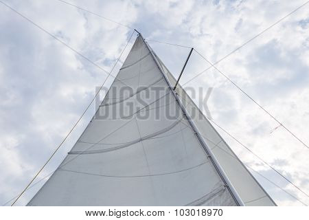 Close Up Of Yacht Sail On Sky Background