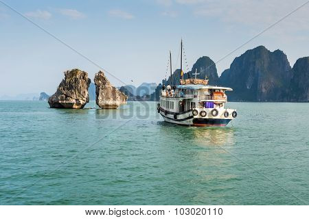 Tourist Boat Visiting Kissing Rocks In Halong Bay, Vietnam