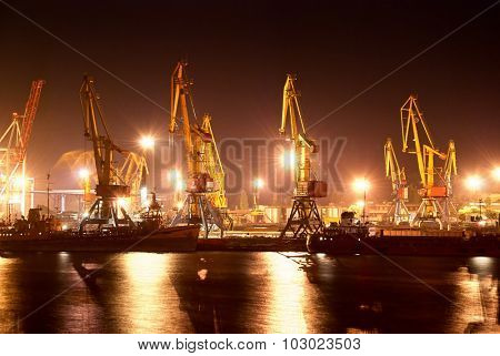 night view of the industrial port with cranes