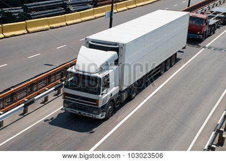 White truck on road. Cargo transportation