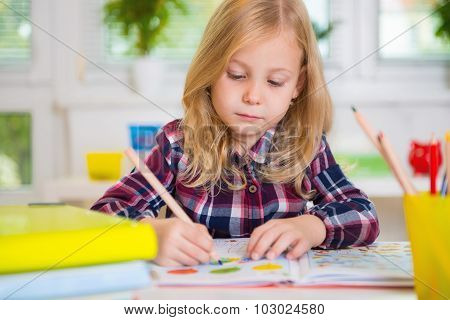 Cute Lovely Girl Drawing At School