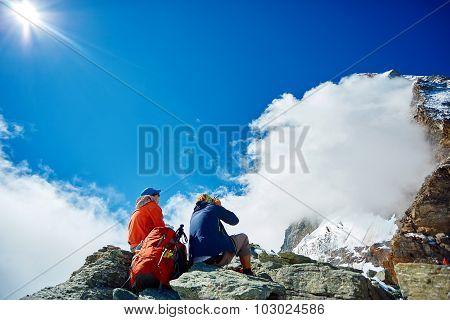 hikers under the Matterhorn mount