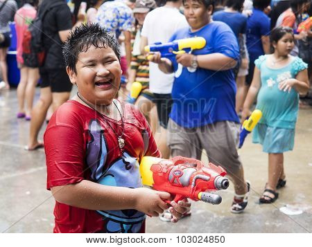 Asian Kid Holding Water Gun At Songkran Festival In Bangkok, Thailand