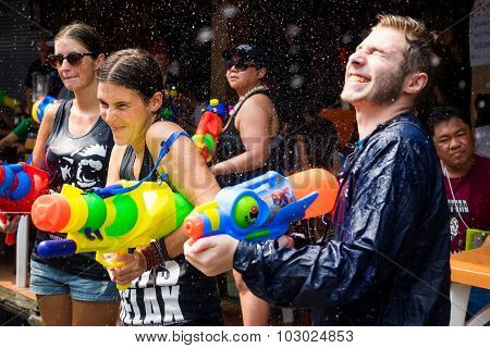 Tourists Shooting Water Guns At Songkran Festival In Bangkok, Thailand