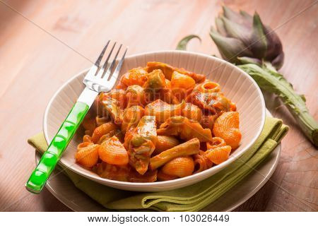pasta with artichoke and tomatoes sauce, selective focus