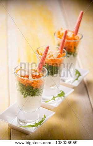 finger food with ricotta arugula carrot and sliced almond