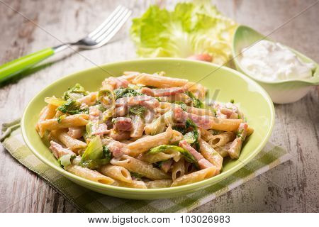 pasta with bacon lettuce and cream sauce, selective focus