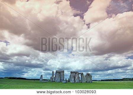 Stonehenge Historic Site On Green Grass Under Blue Sky. Stonehenge Is A Unesco World Heritage Site I