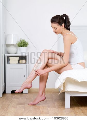 Woman Depilating Her Attractive Legs By Waxing