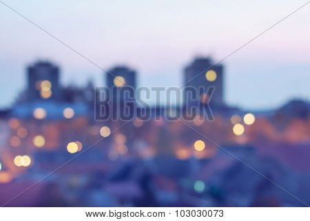 Blurred image of city buildings at night