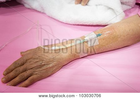 Arm Of Old Woman Patient In Hospital With An Iv