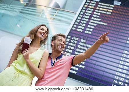 Attractive couple at board at the airport