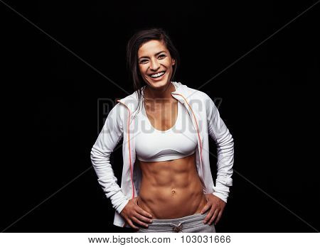 Happy Young Woman In Sports Clothing