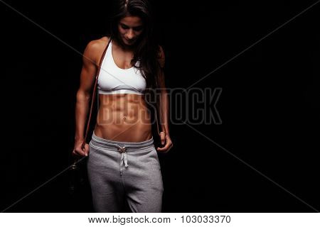 Muscular Young Woman With A Jumping Rope