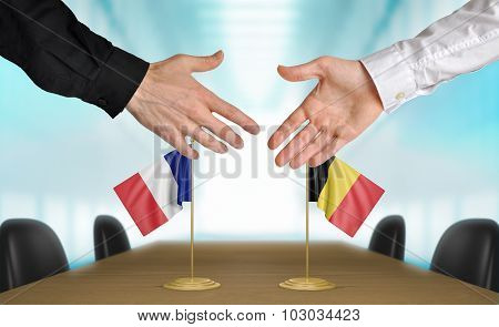 France and Belgium diplomats agreeing on a deal