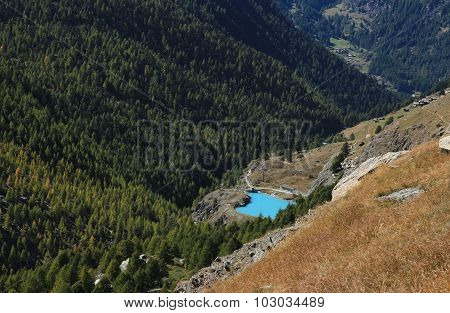 Turquoise Lake Mosjesee And Colorful Larch Forest