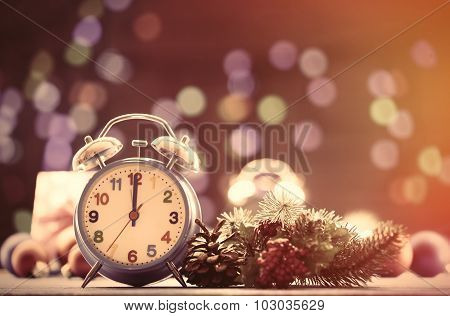 Clock And Pine Branch With Christmas Lights