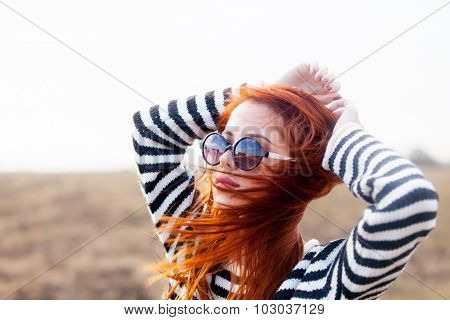 Portrait Of A Young Redhead Girl In Sunglasses