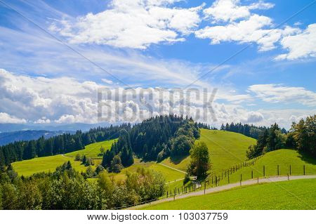 Mountain Landscape With Clouds And Meadows