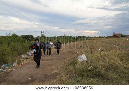 TABANOVCE, MACEDONIA: SEPTEMBER 11, 2015: Immigrants and refugees from Middle East and North Africa crossing Macedonian border.