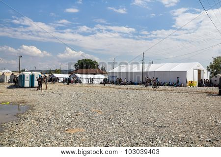 GEVGELIJA, MACEDONIA: SEPTEMBER 11, 2015: Group of  immigrants and refugees from Middle East and North Africa waiting in UNHCR camp.