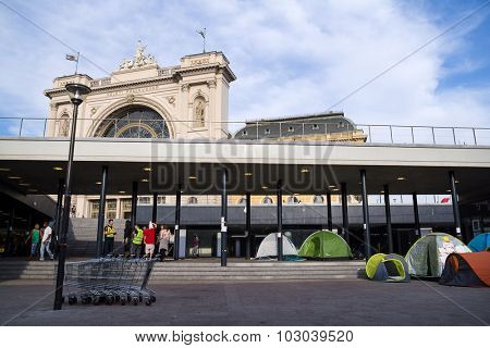 BUDAPEST, HUNGARY: SEPTEMBER 15, 2015: Tents of  immigrants and refugees from Middle East and North Africa in front of train station.