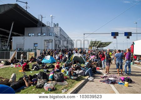 BREGANA, SLOVENIA: SEPTEMBER 19, 2015: Group of immigrants and refugees from Middle East and North Africa at Bregana, state border between Slovenia and Croatia.
